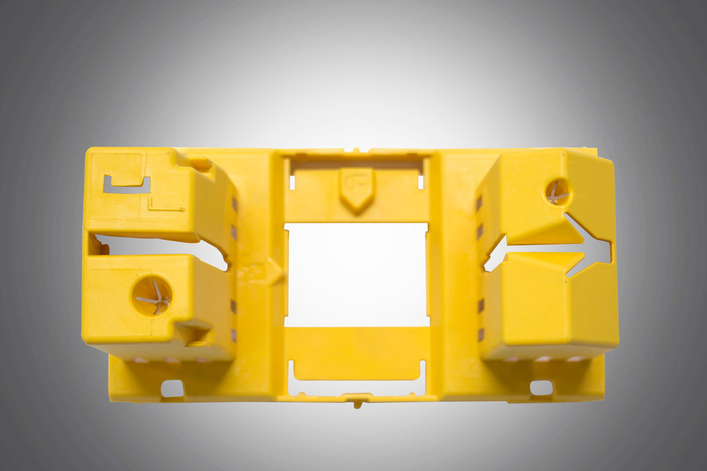 An yellow colour injection moulding component displayed under grey background