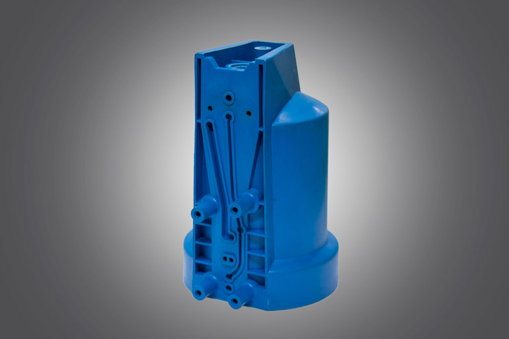 Blue colour injection molding component displayed under grey background manufactured by Techplaastic Industrie p Ltd