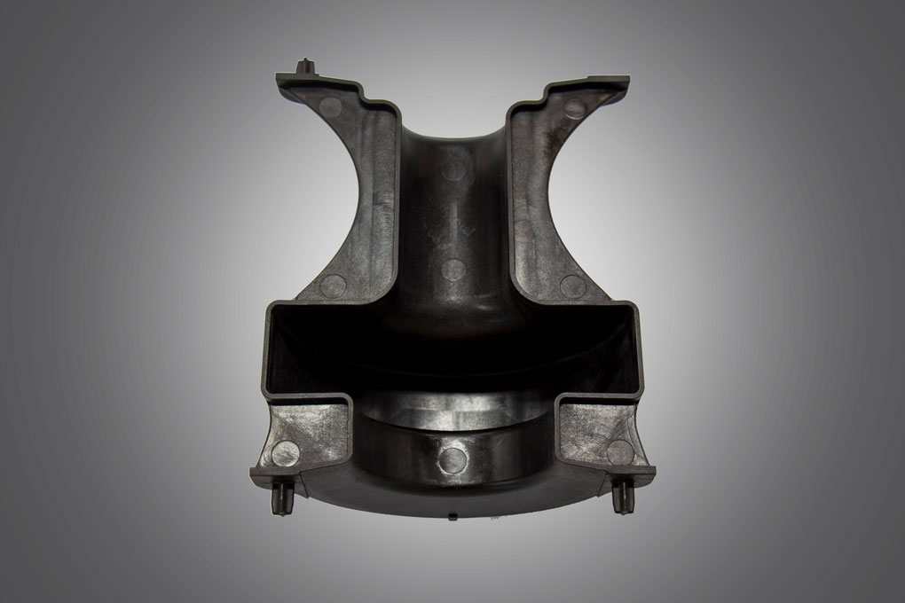 Inside view of black colour injection mould displayed under grey background